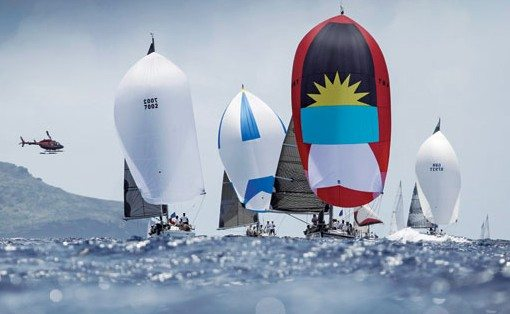 Hugo B proudly flies the flag of Antigua on her spinnaker. Photo: Paul Wyeth/Antigua Sailing Week