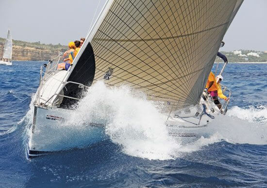 Sir Robert Velazquez's Beneteau L'Esperance on her way to victory in Non-Spinnaker Class. Photo: OceanMedia