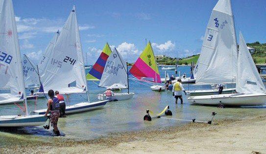 Sailors prepare their boats during the Cruzan Open One Design Regatta