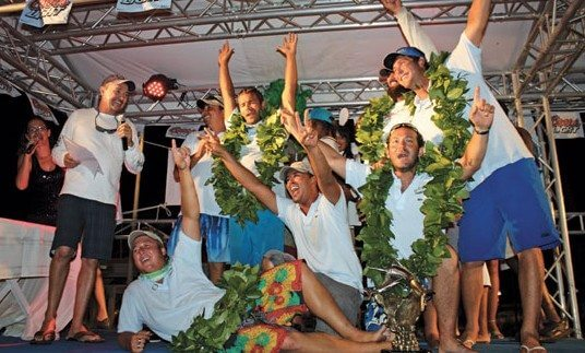 The crew of Yellow Whip celebrate on stage after emerging overall winners of the 15th Annual Saint Martin Billfish Tournament. Photo by Robert Luckock