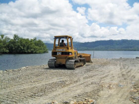 A bulldozer levels the ground where the Bocas del Toro travel-lift pad will be located. Photo: Ray Jason