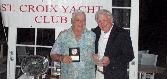 Captain Nick Castruccio (left) receiving his 3rd Community Service Award from Commodore Charlie Fischer at the 2012 St. Croix Yacht Club Commodore's Ball
