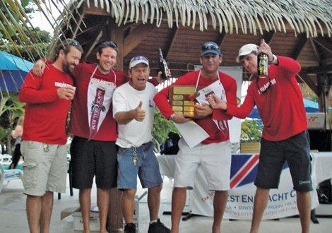 The crew of Firewater celebrate their victory. Photo: West End Yacht Club