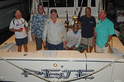 Anglers and crew aboard Peje, top boat after the first day of fishing in the ABMT. Lead angler, Jose Pazos, third from left; fellow angler and Peje owner, Carlos Garcia, far right. Credit: Dean Barnes
