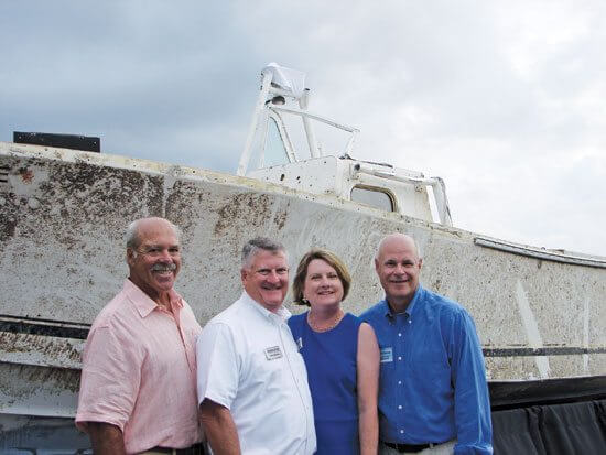 From the left, Rich St. Pierre, Regulator Marine's Owen and Joan Maxwell and Scott Douglas. Photo by Kathy Bohanan Enzerink