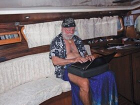 Cap'n Fatty working in the aft cabin of Ganesh, his Wauquiez 43