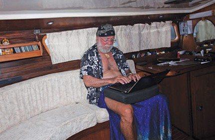 Cap'n Fatty working in the aft cabin of Ganesh, his Wauquiez 43