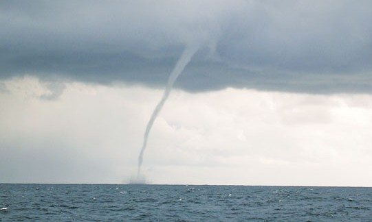 A fully-formed water spout – a wonder to look at but a deadly force in nature. Photo: National Oceanic and Atmospheric Administration