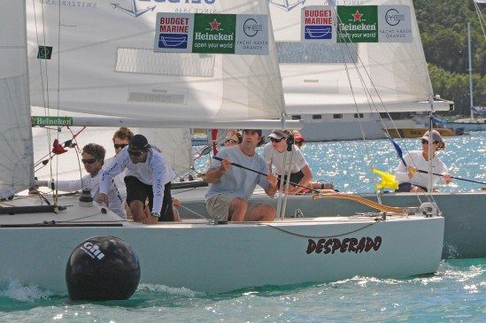 Barkow (far right on the tiller) and Perry battle it out for first in the Finals of the Carlos Aguilar Match Race