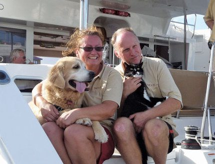 After crossing the Atlantic, Chester and Sparkles receive a cuddle from Silka and Captain Rolf Oetter. Photo courtesy of onboardnextlife.blogspot.com