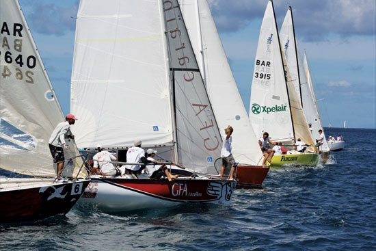 Hungry looking aren't they? Imagine what it was like rounding  the buoy, things got really, really busy! Below: Ladies first!  Adam Foster, IGY's Marina Manager (far right) with the crew of Blonde Attitude who finished first in the J24 Class. Photo by Milton Crombay