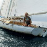 Thomas at the helm of Oasis – notice the boat's sweet lines