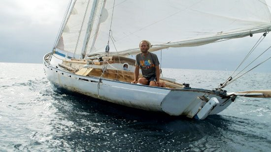 Thomas at the helm of Oasis – notice the boat's sweet lines. Is she ready to sail to Brazil?
