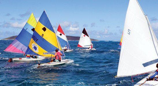 Flight of SCYC Sunfish start in one of 18 races on breezy day one of the Bill Chandler Sunfish Regatta