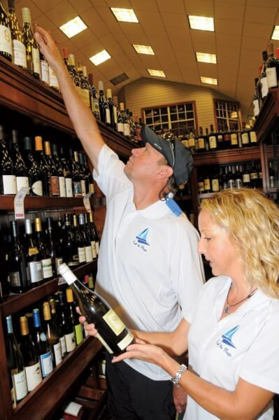 Micheale is a Certified Sommelier with a passion for wine. In this photo, husband Michael helps with the selection