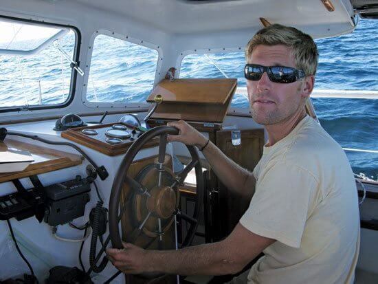 Andy at the helm with his VHF at the ready. Photo by Maria Karlsson