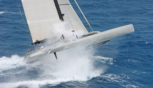 Paradox the first yacht to finish takes to the air. Photography by Tim Wright, Photoaction.com, RORC Caribbean 600