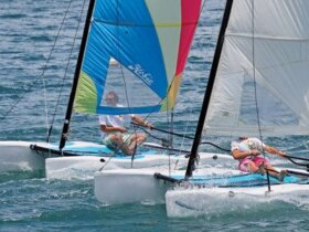 A close finish at PCYC Hobie Cat Match Races. Photo: Dieter Burkhalter