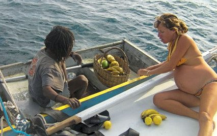 Christina buys fresh provisions from the Dominica fruit mon