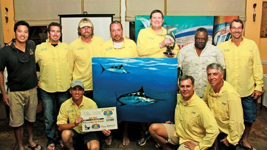 Winners of the 20th Golden Hook Challenge Living the Dream fishing team members (from left, front row): Captain Austin Schneider, David Ziemer and Chris Hanley. Second Row: Peter Chaibongsai (Billfish Foundation Director of Science and Policy), Matt Ridgway, AK Lovarco, Mike Fuller, David Johnson, Spike Herbert and Chad Sheraw; not pictured 'Rasta Dean' Dunham. Photo: Alda Anduze