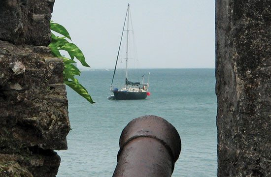 Alianna at anchor on the quieter northern shore under the shadow of Fort San Fernando. Photo by Rosie Burr