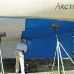 Applying the first coat of antifouling. Photo by Devi Sharp