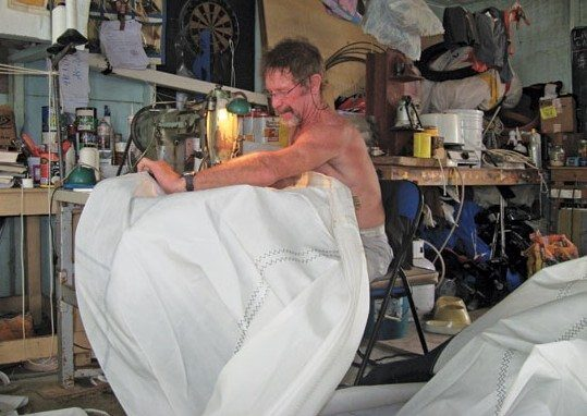 Andy Smelt hard at work in Carriacou's sail loft In Stitches. Photo by Janet Hein