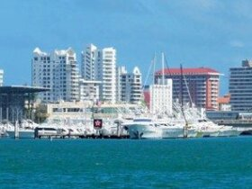 Al Lado del Condado - Club Nautico de San Juan stands in foreground
