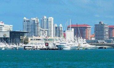 Al Lado del Condado - Club Nautico de San Juan stands in foreground