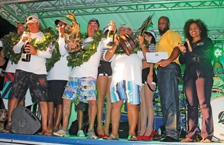 The crew from St. Martin boat Follow Me celebrate on stage at Fort Louis Marina after winning the 16th St. Martin Billfish Tournament. Photo: Robert Luckock