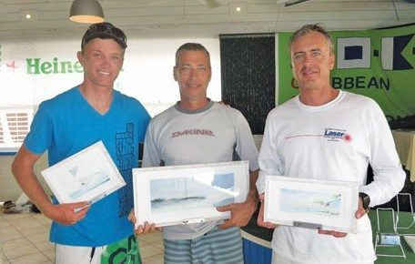 Standard Class winners at the prize giving in Papagayo Restaurant with their Antoine Chapon paintings. From left; Kevin van Otterdijk, winner Ari Barshi, and Benoit Meesmaecker.