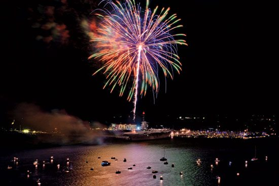 Fireworks explode over the USS Yorktown and vessels anchored off Patriots Point in Charleston Harbor. Courtesy of Patriots Point Naval & Maritime Museum