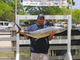 Vince Bryan with his Largest Kingfish, a 34.43-pounder caught during the 24th Annual Bastille Day Kingfish Tournament. Credit: Dean Barnes