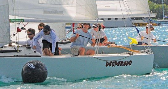 Sally Barkow (tiller, far right) and Dave Perry battle it out in the 2012 finals. Photo: Dean Barnes