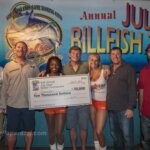 Team Pescador wins 50th July Open Billfish Tournament. L to R: Josh Bourg (mate), Stephen Deckoff, Sr. (top angler), Stephen Deckoff, Jr. (angler), Capt. Jay Fowler, Mark Jenkins (mate), holding hand-carved marlin head trophies by marine artist, David Wirth.