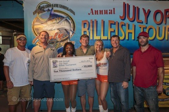 Team Pescador wins 50th July Open Billfish Tournament. L to R: Josh Bourg (mate), Stephen Deckoff, Sr. (top angler), Stephen Deckoff, Jr. (angler), Capt. Jay Fowler, Mark Jenkins (mate), holding hand-carved marlin head trophies by marine artist, David Wirth.