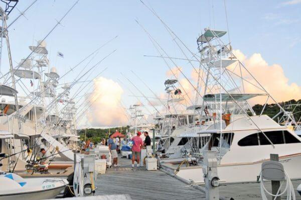 Sports fishing boat line the docks in summer. Photo by Dean Barnes