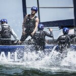 Team members of All In Racing of Germany perform during the speed trial of the Red Bull Youth America's Cup in San Francisco, California on August 31, 2013.
