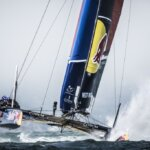 Team members of Next World Energy of France perform during the speed trial of the Red Bull Youth America's Cup in San Francisco, California on August 31, 2013.