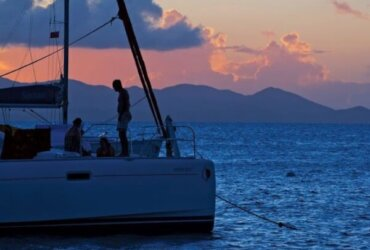 Forget about hotels or shore-bound inns. When you charter you get your own room with a view - like this sunset over Tortola. Photo: www.sherryspix.com