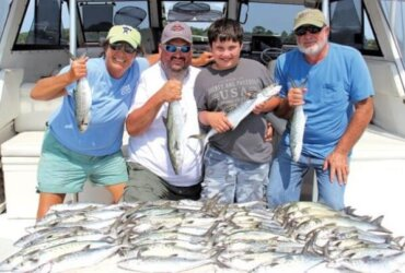 Capt. Kathy, Corey Childers and son Dylan, and grandfather Randy Cochran