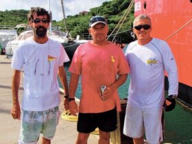Proud winners of the PCYC Mott Memorial Hobie Cat Challenge (L-R): Dave Royce (2nd), Mike Bingley (1st), and Richard Szyjan (3rd). Photo: Connie Martin