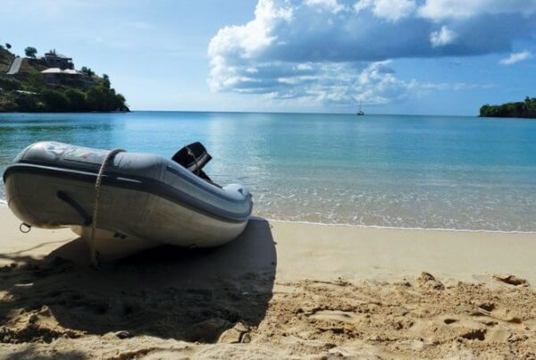 The quiet shaded beach and pristine lapping waters of Morne Rouge Bay often is overlooked by cruisers due to its shallow depths