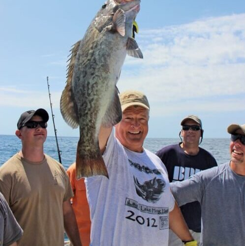 Mike McAvoy is proud of his gag grouper, which he reeled in just before a shark took a bite out of it!