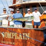 Capt. Mullins McLeod and crew celebrate a good day of fishing. Photo By Jeff Dennis