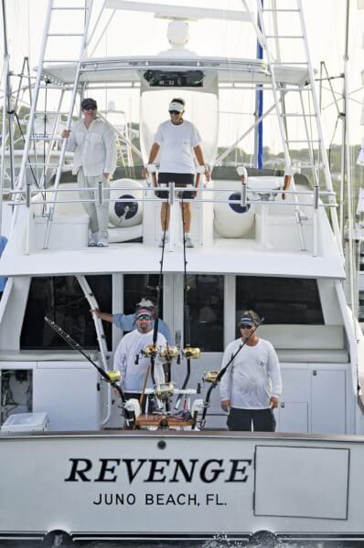 Captain Lemon (center on bridge) backing Revenge into its slip at American Yacht Harbor. Photo: Dean Barnes
