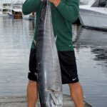 Angler Kirkley Russell with his 71.8-pound wahoo at the MegaDock. Photo By Jeff Dennis