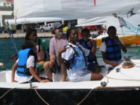 The USA's Dave Perry sails with students in the Carlos Aguilar Youth Regatta. Credit: Dean Barnes