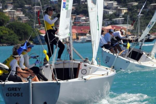 Brazil's Juliana Senfft and team trail the USVI's Peter Holmberg and crew in a match during the 2012 Carlos Aguilar Match Race. Credit: Dean Barnes