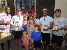 Winners receive signature timepieces from Cardow Jewelers: L to R: Awards Presenter, Julius Jackson, Don Wilson, Teddy Nicolosi, Josh McCaffrey, Amanda Engeman, Willem van Waay, Jordan Reece. Standing in front, Wilson's children Annabel, Ava and Oliver. Credit: Dean Barnes
